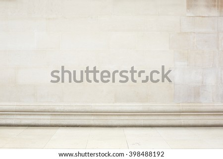 Beige stone tiled wall and floor with decoration border - stock photo