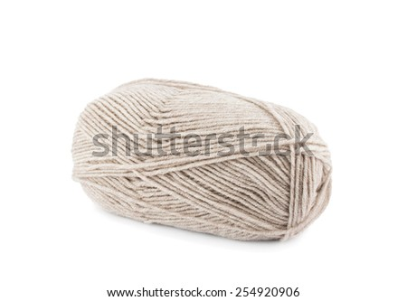 Beige wool yarn ball isolated on a white background - stock photo