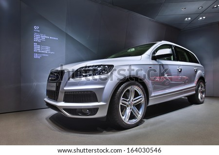 BEIJING-APRIL 17. Audi Q7 in a showroom. Audi cars remain in high demand in US and China. Strong sales in those markets boosted Audi to new record for first eight months 2013. Beijing, April 17, 2013 - stock photo