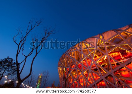 BEIJING - APRIL 13 : Beijing National Stadium or the Bird's Nest stadium at Dusk on April 13, 2010 in Beijing, China. Was a landmark of modern China located on Beijing Olympic Green. - stock photo