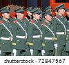 BEIJING - APRIL 2: Chinese soldiers prepare for the national flag ceremony on April 2, 2010 in Beijing, China. Every movement needs to be very precise. - stock photo