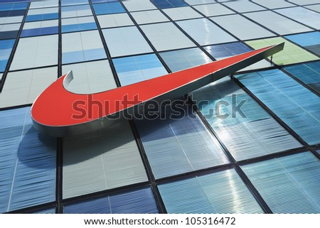 BEIJING-APRIL 6:Facade of a Nike store in Beijing on April 6, 2012. It took Nike 25 years to reach $1 billion annually sales in China and the company doubled that number last fiscal year. - stock photo