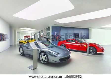 BEIJING-APRIL 6. Ferraris in a showroom. The rise of female Chinese entrepreneurs: Chinese women buy twice as many Ferraris than Western women, according recent Forbes article. Beijing, April 6, 2013. - stock photo