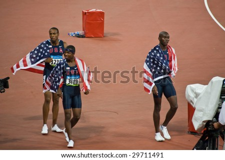 BEIJING - AUG 18: Angelo Taylor, Kerron Clement, and Bershawn Jackson take a victory lap after USA sweeps men's 400 meter hurdles with gold, silver and bronze. Beijing, China August 18, 2008