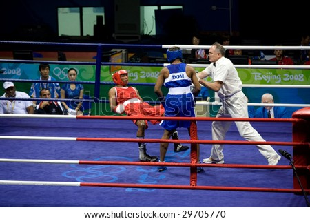 BEIJING - AUG 16: Boxer Alfonso Blanco Parra of Venezuela falls after a punch from Argenis Nunez of the Dominican Republic. Parra later goes on to win the bout. August 16, 2008 Beijing, China