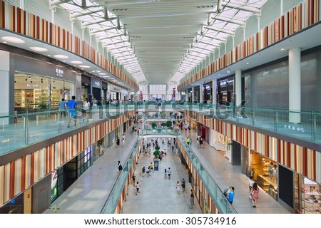 BEIJING-AUG. 2, 2015. Inside Livat shopping mall. Owned by Inter Ikea Centre Group, its design is uniquely Scandinavian with a spacious atrium for visitors searching for a unique airy indoor space. - stock photo