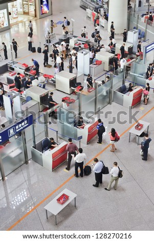 BEIJING-AUG. 30. Security check area, Beijing Capital Airport Terminal 3. The airport registered 488,495 aircraft movements (take-offs & landings), ranked 10th in the world. Beijing, Aug. 30, 2010. - stock photo