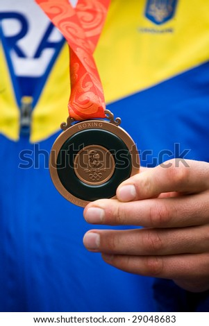 Beijing - Aug 24: Vyacheslav Glazkov of Ukraine shows his bronze medal from super heavyweight boxing division at the 2008 Olympic games August 24, 2008 Beijing, China.