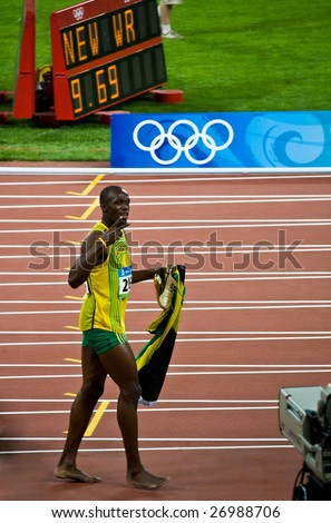 BEIJING - AUGUST 16:  Sprinter Usain Bolt sets new world record for men's 100-Meter sprint at the Olympic games. Bolt would later gain the title World's Fastest Man August 16, 2008 Beijing, China - stock photo