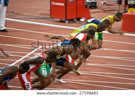 BEIJING - AUGUST 18: Start of Men's 100 meter sprint where Usain Bolt wins and sets a new world record at the 2008 Summer Olympic Games August 18, 2008 in Beijing, China. - stock photo