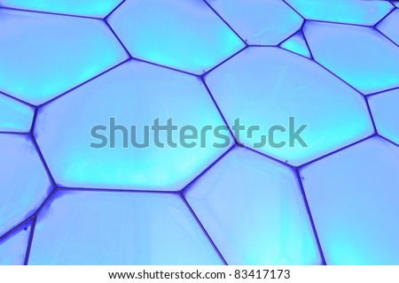 BEIJING - AUGUST 22. Surface of Beijing Olympic Water Cube at night time on August 22, 2011. It hosted diving and swimming events Its capacity was 17000m2 and is reduced to 6.000 after the Olympics. - stock photo