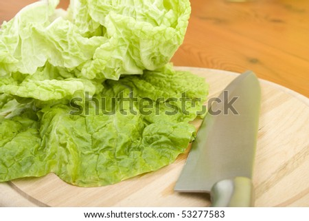 Beijing cabbage lay on a wooden board near a knife