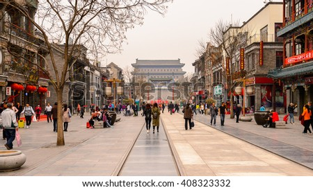 BEIJING, CHINA - APR 6, 2016: Qianmen street, famous commercial street in Beijing, China. It is 840 m long and 21 m and has the age of over 570 years.