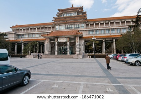 BEIJING, CHINA - APRIL 1: Chinese people walks in front of The National Art Museum of China building at 1 Wusi Ave in Dongcheng District on March 31, 2013 in Beijing on April 1, 2013 in Beijing - stock photo
