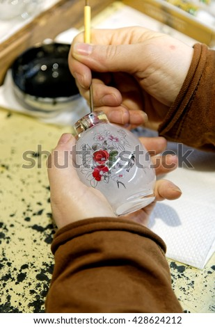 BEIJING, CHINA â?? April 13, 2106: Craftsman perform Chinese reverse glass painting - stock photo