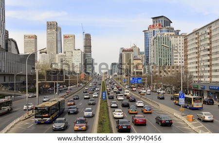 BEIJING, CHINA - APRIL 2, 2016: Skyline of modern buildings and heavy Traffic jam are seen at downtown city - stock photo