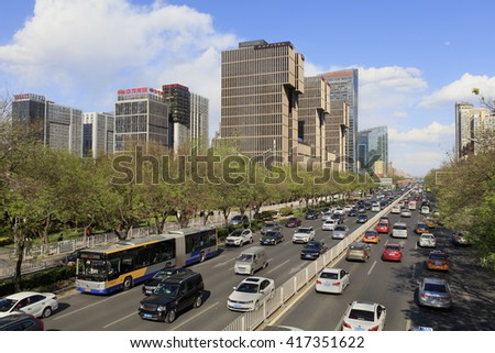 BEIJING, CHINA - APRIL 17, 2016: Skyline of modern buildings and traffic jam are seen at Beijing's Central Business District. - stock photo