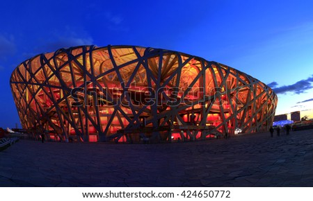 BEIJING, CHINA - APRIL 16th:  China Beijing National Stadium  know as bird nest stadium light-up against blue twilight, April 16th, 2016 in Beijing, China - stock photo