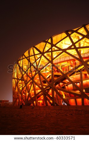 BEIJING, CHINA - AUG 8: First anniversary celebration of Olympic game on August 8, 2009 in Beijing. Stadium is light up in red. - stock photo