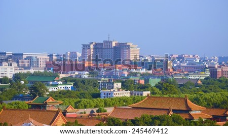 BEIJING, CHINA, AUGUST 21, 2013: view of the forbidden palace complex and surrounding neighborhood taken from them top of jingshan park in beijing. - stock photo