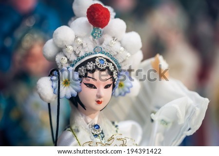 BEIJING, CHINA - DEC 16: Souvenir store's display window, December 16, 2013 in Beijing, China. Chinese classical character model is tourist souvenirs - stock photo