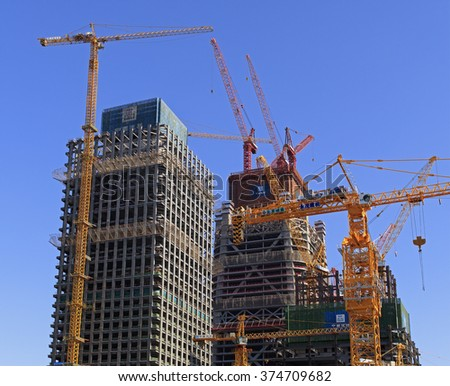 BEIJING, CHINA - FEBRUARY 5, 2016: On-going construction are seen are seen around Beijing Central Business District (CBD).  The Beijing CBD is located in the Chaoyang district, occupies about 3.99 km2 - stock photo