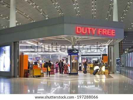 BEIJING, CHINA-JAN.23, 2014: People is seen in a Duty free shop at Beijing Capital International Airport. As of 2014, this airport is the busiest airport in the world in terms of passenger throughput  - stock photo