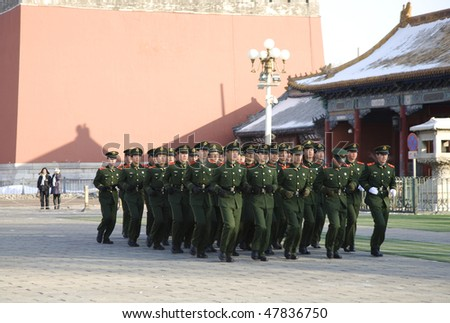 BEIJING, CHINA - JANUARY 16: A group of security stuff patrol in Tian'anmen Square after the dawn flag raising ceremony January 16, 2010 in Beijing, China. - stock photo