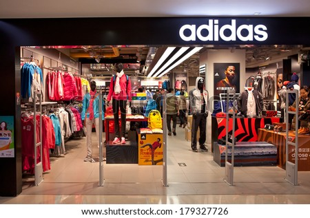 BEIJING, CHINA - JANUARY 2, 2014: Shoppers are seen at a Adidas store; Adidas, a German multinational corporation founded in 1948, is the second biggest sportswear manufacturer in the world. - stock photo