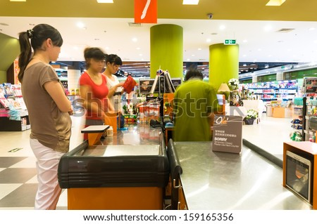 BEIJING,CHINA - JULY 6: Hualian supermarket cashiers on July 6th 2010 in Beijing. Hualian is China's first supermarket chains listed companies. - stock photo