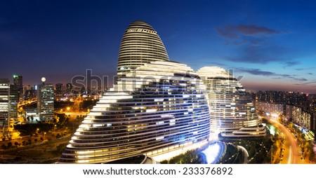 Beijing,China-July 13th,2014:cityscape and famous landmark building,WangJing Soho at night. - stock photo
