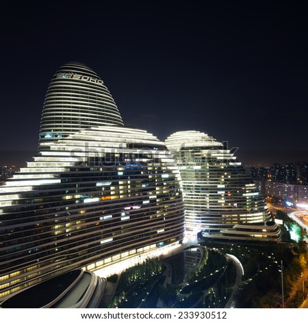 Beijing,China-July 13th,2014:cityscape and famous landmark building,WangJing Soho during sunset. - stock photo