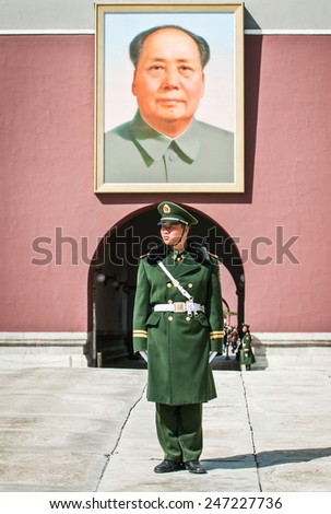 BEIJING, CHINA - MARCH 27: Chinese soldier stands at attention in front of Gate of Heavenly Peace (Tiananmen) on March 27, 2013 in Beijing - stock photo