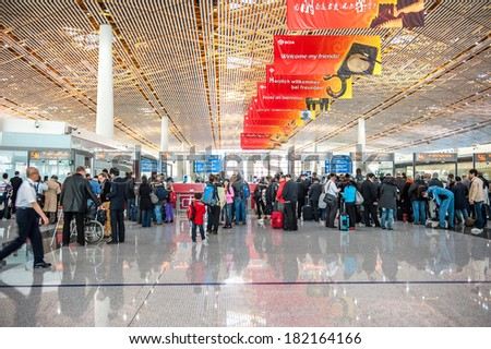 BEIJING,CHINA - MARCH 28 ,2011:Passengers at passport control of arrival hall  Beijing Capital Airport in China.The airport has registered 488,495 aircraft movements  and ranked 10th in the world. - stock photo