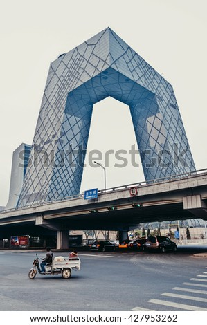 Beijing, China - March 30th, 2013: CCTV Headquarters - modern building of China Central Television on East Third Ring Road, Guanghua Road in the Beijing Central Business District (CBD) - stock photo