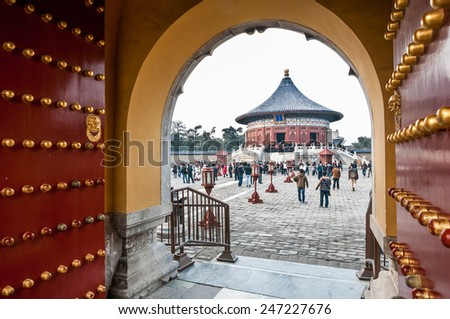 BEIJING, CHINA - MARCH 26: Tourists on a courtyard of The Imperial Vault of Heaven area in Temple of Heaven on March 26, 2013 in Beijing - stock photo
