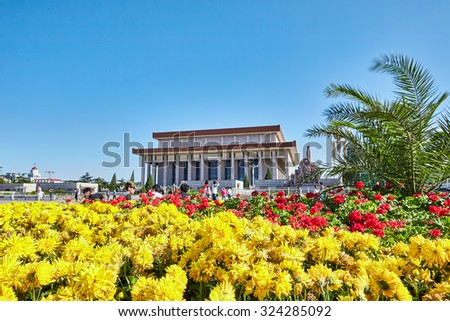 BEIJING, CHINA - MAY 19, 2015: People walk on Tiananmen Square near Mao Zedong mausoleum - the largest square in the world, Beijing. China. - stock photo