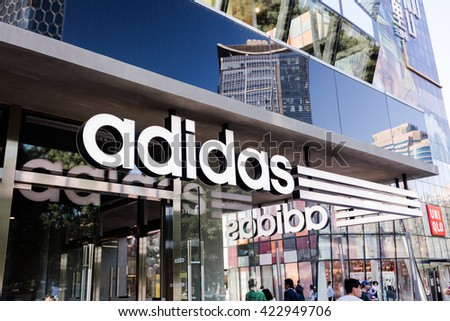BEIJING, CHINA - May 12, 2016: Shoppers are seen at a Adidas store; Adidas, a German multinational corporation founded in 1948, is the second biggest sportswear manufacturer in the world.