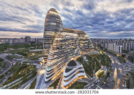 Beijing,China-May 11th,2015:cityscape and famous landmark building,WangJing Soho at night. - stock photo