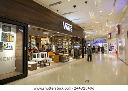 BEIJING, CHINA-NOV. 13, 2014: Vans store; Vans is an American shoes manufacturer that also produces apparel, and other products. The brand is available in more than 170 countries worldwide. - stock photo