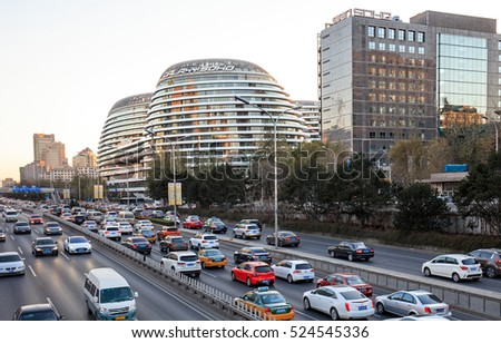 BEIJING, CHINA-NOVEMBER 27, 2016: Traffic jam is seen on the second ring road, next to Galaxy SOHO in city downtown. This ring road passes through very central parts of Beijing.