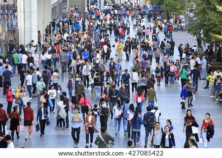BEIJING, CHINA - OCTOBER 3, 2015: Unidentified people crowd Xidan commercial area. Xidan is an traditional commercial area located in Xicheng District and it occupies around 80 hectares. - stock photo