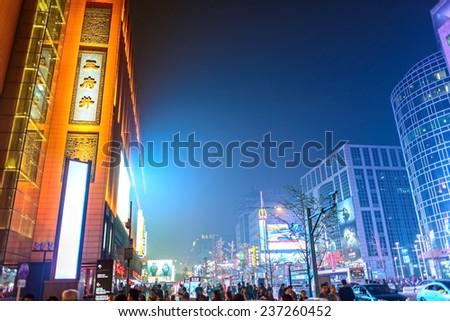 BEIJING, CHINA - OCTOBER 24, 2014: Wangfujing Street at night. People are walking. Located in Beijing, China. - stock photo