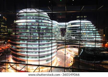 Beijing,China-on December 31st, 2015:The Modern Architecture Beijing Galaxy SOHO building scenery,the landmark of Beijing,design by Zaha Hadid. - stock photo