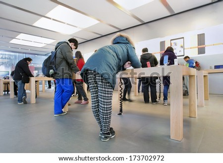 BEIJING, DEC. 29. Apple outlet. After six years negotiations, Apple has a multi-year deal with China Mobile, China's largest wireless carrier, to sell its iPhone in China. Beijing, Dec. 29, 2013 - stock photo