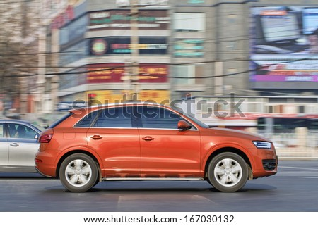 BEIJING-DEC. 6. Audi Q3 SUV. Audi controls 30% of the Chinese market, its rival BMW controls 24%, Audi now sells almost twice as many vehicles in China as it does in Germany. Beijing, Dec. 6. 2013. - stock photo