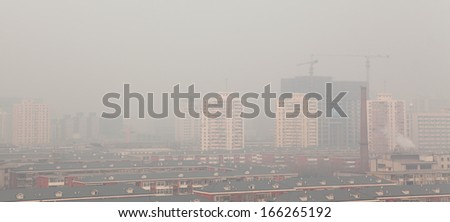 "BEIJING - DEC 7: Beijing skyline and smog on Dec 7, 2013 in Beijing, China.  The pollution was recorded in central and eastern regions of the country at orange level which is called ""hazardous level."" - stock photo"