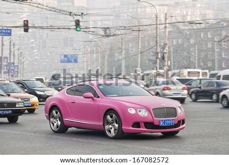 BEIJING-DEC. 6. Bentley Continental GT V8. Bentley sales in China fell 17 percent the first nine months of 2013, because extremely luxury cars became a symbol of corruption. Beijing, Dec. 6. 2013. - stock photo