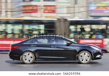 BEIJING-DEC. 12. Hyundai Santa Fe. Hyundai considers fourth plant in China to maintain its 10% market share in 2015-2016, when Chinese market grows to 20 million cars a year. Beijing, Dec. 12. 2013. - stock photo
