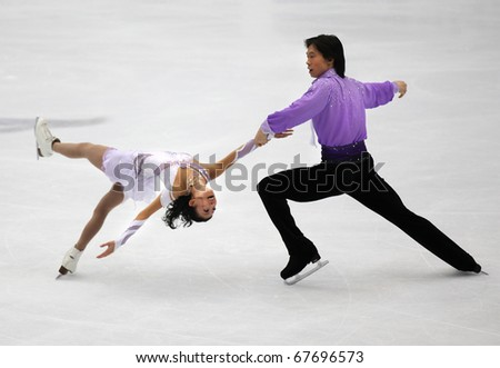 BEIJING-DEC 11: Qing Pang and Jian Tong of China perform in the Pairs-Free Skating event of the ISU Grand Prix of Figure Skating Final on Dec 11, 2010 in Beijing, China. - stock photo